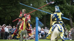 FILE - In this file photo dated July 5, 2014, People are dressed as knights on horseback take part in a medieval jousting tournament at Linlithgow Palace, Linlithgow, Scotland. The charity English Heritage has launched a campaign Thursday July 20, 2016, for the ancient equestrian sport of Jousting to be included on the program at future Summer Olympic Games. (Jane Barlow / PA FILE via AP)